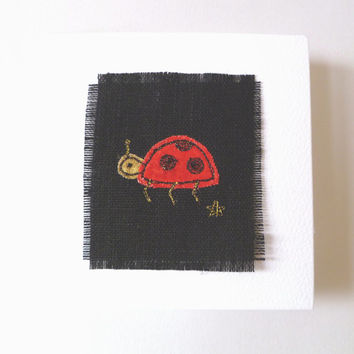 Ladybird greetings card. Handmade embroidered card with cute red and black ladybird. Blank for your own message. Made in England.