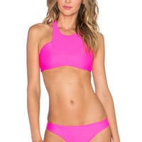 Stone Fox Swim Bambi High Neck Sport Bikini Top in Pitaya