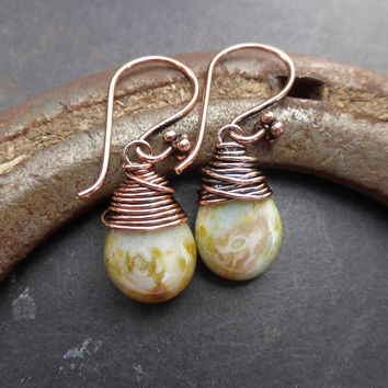 Light mossy green Czech Picasso glass teardrop and copper wrapped earrings. Small  jewelry.