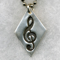 Diamond shaped Silver pendant with a musical note - trebleclef