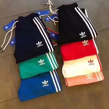 (adidas) comfortable striped slim fit sweatpants.