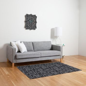 Heather Dutton Transit Black Woven Rug
