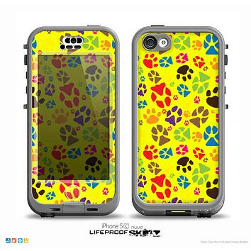 The Colorful Scattered Paw Prints Over Yellow Skin for the iPhone 5c nüüd LifeProof Case