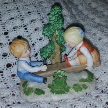 Lovely Vintage Porcelain Figurine of a Little Boy and Girl on a See Saw Teeter Totter