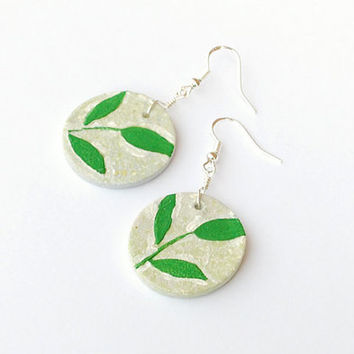 Hand painted circular clay bead earrings with green leaf motif. Forest fairy gift idea - box included! Spring plants, nature jewelry.