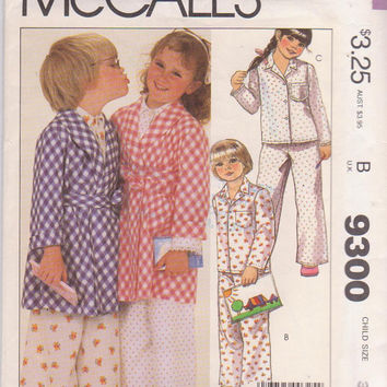 Vintage 1980s pattern for child's winter wrap front bathrobe and long sleeved, button front pajamas size 3 breast 22McCall's 9300 UNCUT