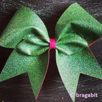Multicolor green glitter on pink ribbon.