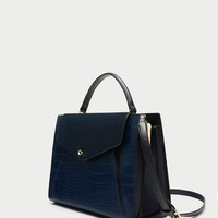 EMBOSSED CITY BAG WITH CONTRASTING LEATHER FLAP