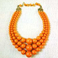 Vintage Orange Lucite Beaded Necklace with 3 Strands & Adjustable Closure from the 1950s