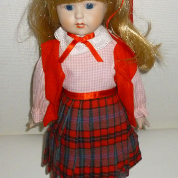 Heritage Dolls Musical Blond Haired Porcelain Doll in A Red Plaid Dress