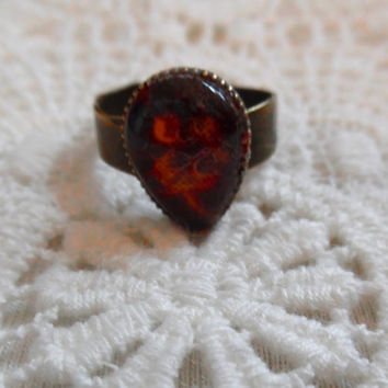 Dark red resin cabochon/bronze adjustable tear drop/fabric flower ring
