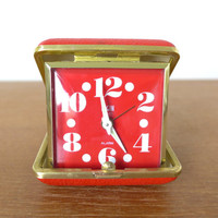 Working red Elgin travel alarm clock with large, graphic numbers
