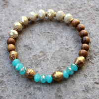 Calm and inspiration, blue and beige crystal, wood and African Trade Beads bracelet