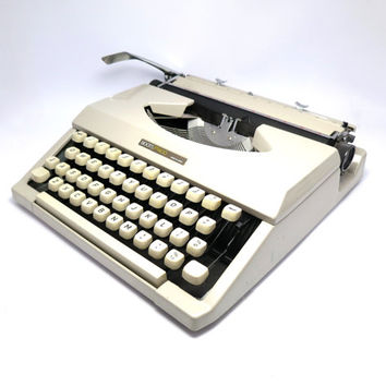 White Portable Typewriter- Boots PT400. In Working Condition and Good Condition. Carry Case Included. Made in Japan.
