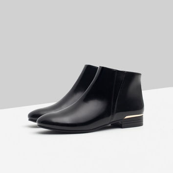 FLAT ANKLE BOOTS WITH METAL DETAIL