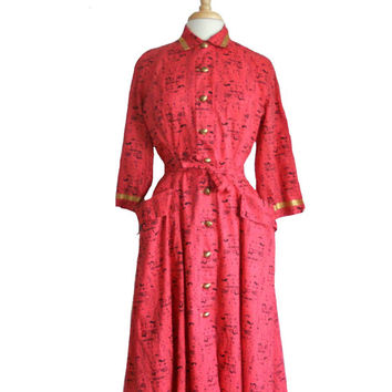 Vintage Dress 1960s Coral Pink Button Down Daytime Lounge Dress Gold Ribbon Trim Egyptian Style Print and Gold Tone Buttons by Loungees