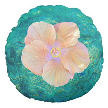 Hibiscus on turquoise water outdoor pillow