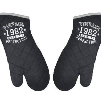 Set of 2 Personalized Vintage Birth Year Black Fabric Oven Mitt by TooLoud