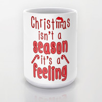 Christmas Isn't A Season It's A Feeling Mug by LookHUMAN