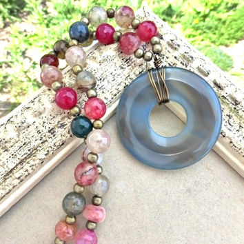 Blue agate donut stone, agate stones, bronze metal necklace. Blue, pink, peach.