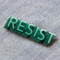 """Resist"" Enamel Pin in Green"