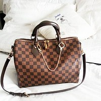 Free Shipping-LV Tide brand men and women personality wild travel bag large capacity handbag