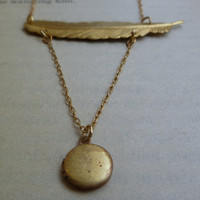 Feather locket necklace by littlepancakes on Etsy
