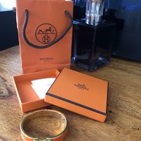 Hermes Ceramic in Classic Orange w/ Gold H Clic Clac Bangle 12mm (with box&bag)