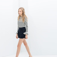 STRIPED TOP WITH FRILLY CUFF