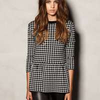 Black and White Houndstooth Long Sleeve Ruffled Bottom Top