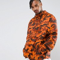 Puma Pullover Windbreaker In Camo Print In Orange Exclusive to ASOS 57663602 at asos.com