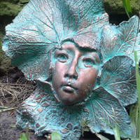 Art for your garden wall, fence and gate, handcrafted sculpture of a female face surrounded by leaves.  Autumn by Gable Gargoyles