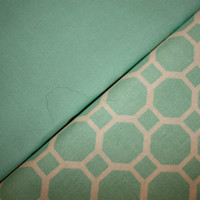 Light teal coordinating fabrics, 1 yard each. One solid color and one with a cobblestone like design in white.