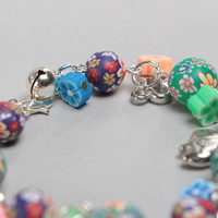 Beautiful handmade children's polymer clay wrist bracelet with charms