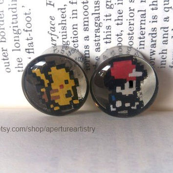 Pair of hand drawn Pokemon plugs sizes 8mm and above.