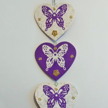 Hanging heart decoration, with die cut butterflies, purple and white embroidery thread and beads. Purple and white hanging mobile.