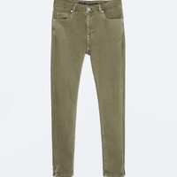 Skinny trousers with zipped hem