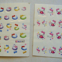2 sheets of rainbow and pink hello kitty water transfer nail sticker, 20 pcs each sheet