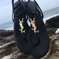 YSL new flat toe sandals are a perfect fit for the Roman fashion trend with one-word button metal letters