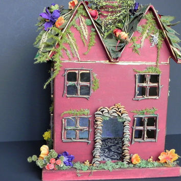 Fall fairy house. Three LED votitves give it a golden glow. Indoor garden, fall display, or night light for older child.