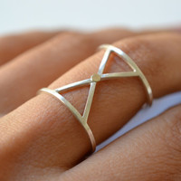 X : silver and gold geometric ring