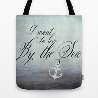 I want to live by the sea - black Tote Bag by Mockingbird Avenue