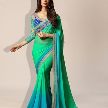 The dreaming of summer designer saree in tonal green