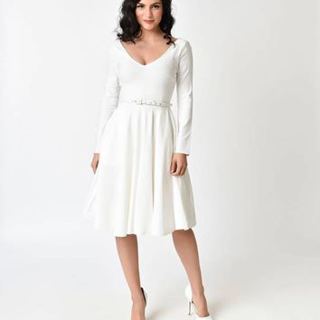 Unique Vintage 1950s Ivory Stretch Long Sleeve Maude Swing Dress