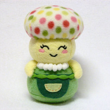 Plush mushroom with apron and necklace