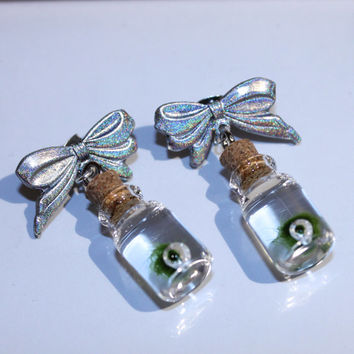 holographic bow earrings with nano MARIMO moss ball