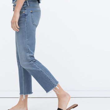 JEANS WITH FRAYED HEM New