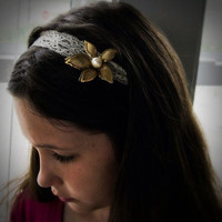 Vintage, gold tone flower hair piece with with an ivory color faux pearl sewn on a stretch ivory lace hair band.