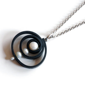 Recycled inner tube circle swirl pendant with white freshwater pearls , black swirly twirly jewelry , rubber spiral pendant , whirl pendant