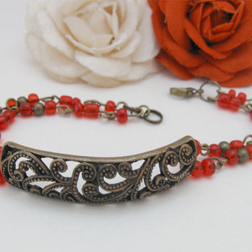 Red Currant - brass bracelet with red beads and bronze art deco ornament